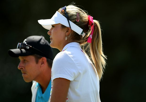 Lexi Thompson with her caddie Greg Johnston on Saturday at the Kraft Nabisco Championship.