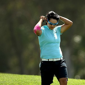 Yani Tseng loses her hat in strong winds on Saturday at the Kraft Nabisco Championship.
