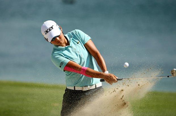 Yani Tseng hits out of the bunker at No. 6 on Saturday at the Kraft Nabisco Championship.