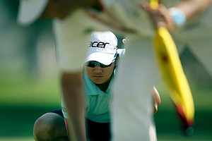 Yani Tseng lines up a putt on Saturday at the Kraft Nabisco Championship.