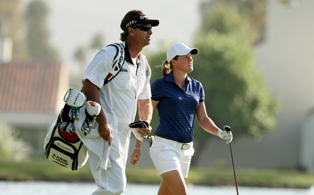 Karin Sjodin walks with her caddie up No. 18 on Saturday at the Kraft Nabisco Championship. She and Yani Tseng are tied for the lead.