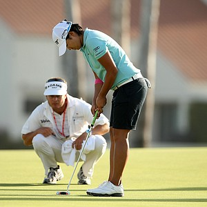 Yani Tseng and her caddie Jason Hamilton line up her putt at No. 18 on Saturday at the Kraft Nabisco Championship.