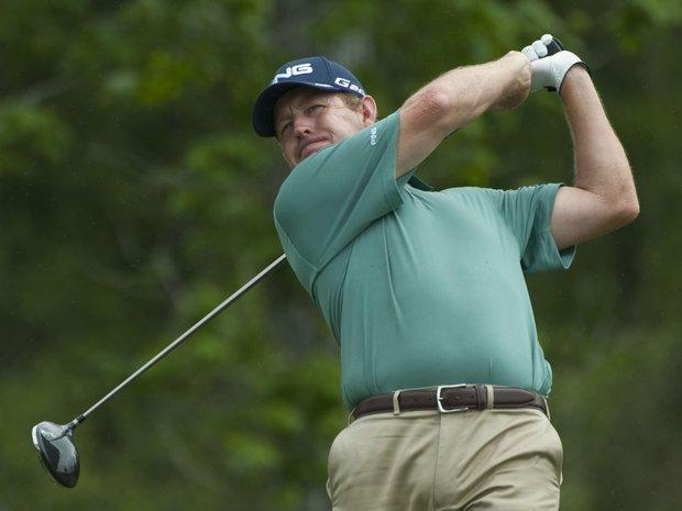 Jeff Maggert watches his tee shot on the 13th hole during the first round of the Houston Open.