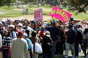 "A fan carries a sign for Yani Tseng during the final round of the Kraft Nabisco Championship. In Taiwan fans call her ""Ni Ni."""