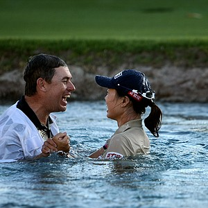 Sun Young Yoo and her caddie Adam Woodward celebrate in Poppie's Pond after winning in a playoff during the final round of the Kraft Nabisco Championship.