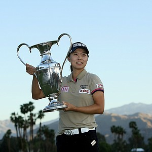 Sun Young Yoo holds the trophy after a playoff in the final round of the Kraft Nabisco Championship.