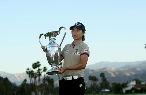 Sun Young Yoo holds the trophy after a playoff  during the final round of the Kraft Nabisco Championship.