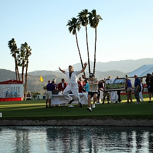 Sun Young Yoo and her caddie Adam Woodward jump into Poppie's Pond after winning in a playoff in the final round of the Kraft Nabisco Championship.