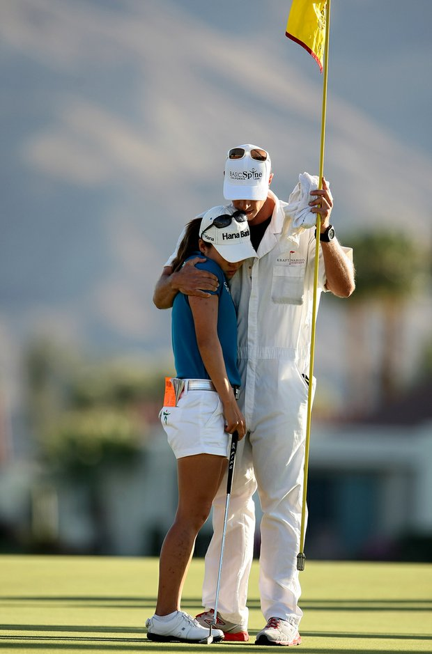 I. K. Kim is consoled by her caddie at No. 18 during the final round of the Kraft Nabisco Championship.
