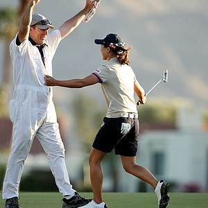 Sun Young Yoo and her caddie Adam Woodward celebrate at No. 18 during a playoff in final round of the Kraft Nabisco Championship.