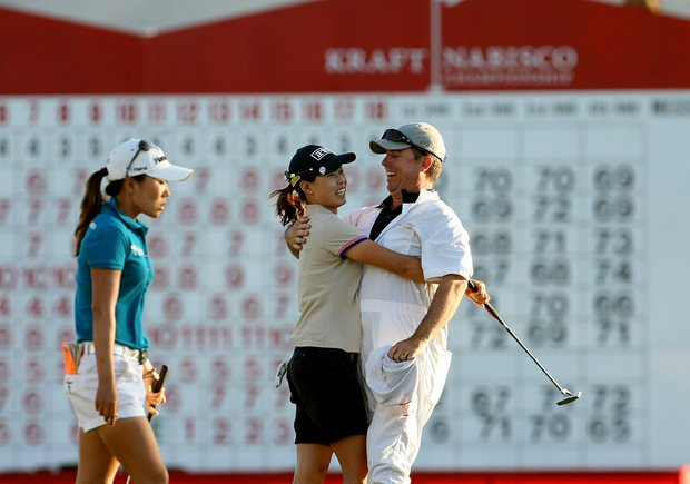 Sun Young Yoo and her caddie Adam Woodward celebrate after the first playoff hole during the final round of the Kraft Nabisco Championship. I.K. Kim, left, missed a 1-footer in regulation to win the title.