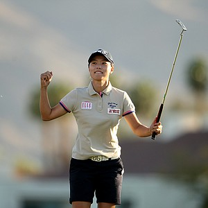 Sun Young Yoo celebrates after winning in a playoff during the final round of the Kraft Nabisco Championship.