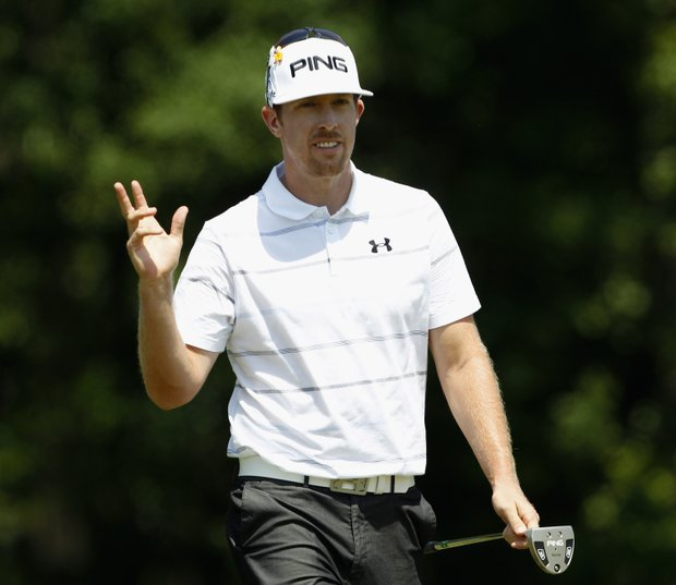Hunter Mahan waves to the gallery after missing his par putt on the second hole during the final round of the Shell Houston Open.