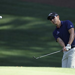 Sang-Moon Bae, of Korea, chips to the 10th green during a practice round for the Masters.