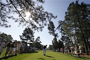 K.J. Choi, of Korea, tees off at the ninth hole during a practice round for the Masters.