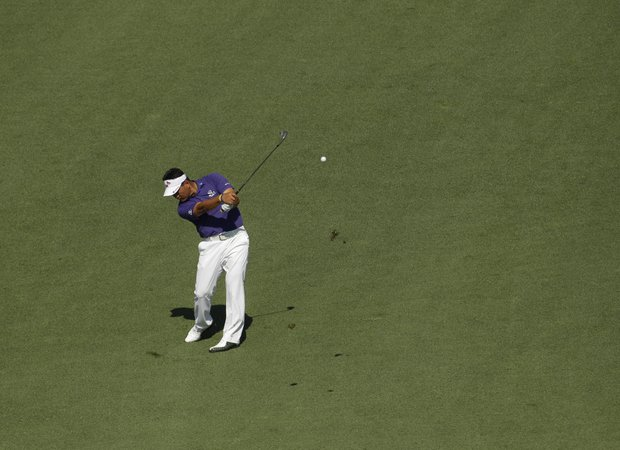 K.J. Choi, of Korea, hits off the ninth fairway during a practice round for the Masters.