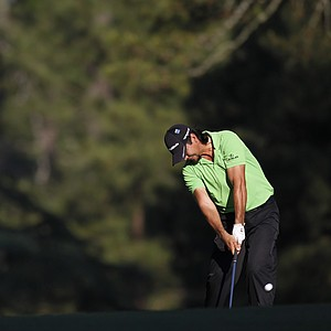 Jason Day, of Australia, hits off the 14th fairway during a practice round for the Masters.