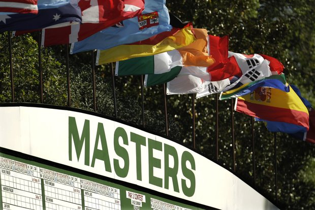 Flags from various countries flap in the breeze during a practice round for the Masters.