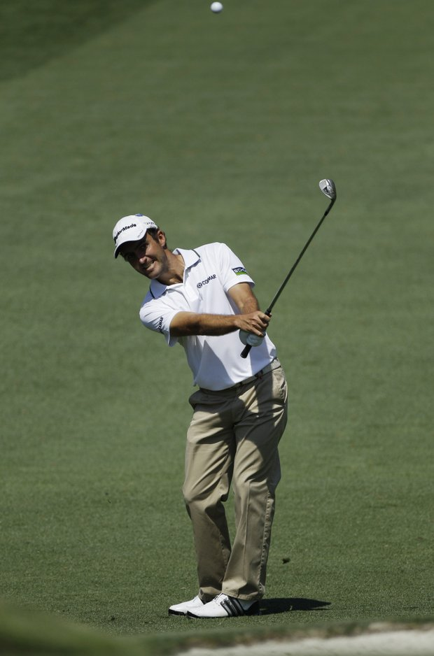 Edoardo Molinari, of Italy, watches his chip shot to the second green during a practice round for the Masters.