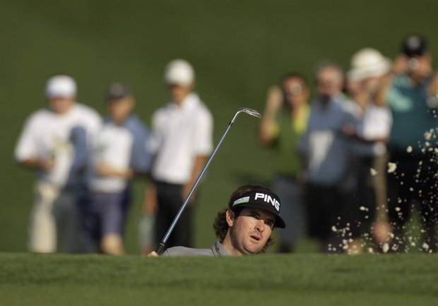 Bubba Watson watches his shot out of a bunker on the ninth hole during a practice round for the Masters.