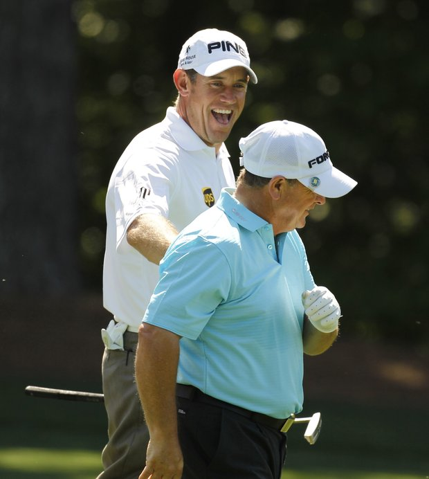 Lee Westwood, left, of England, jokes with Ian Woosnam, of Wales, on the 11th fairway during their practice round for the Masters.