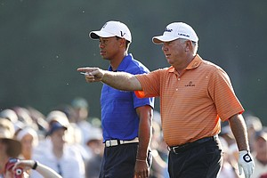 Tiger Woods, left, walks to the 12th tee with Mark O'Meara during a practice round for the Masters.