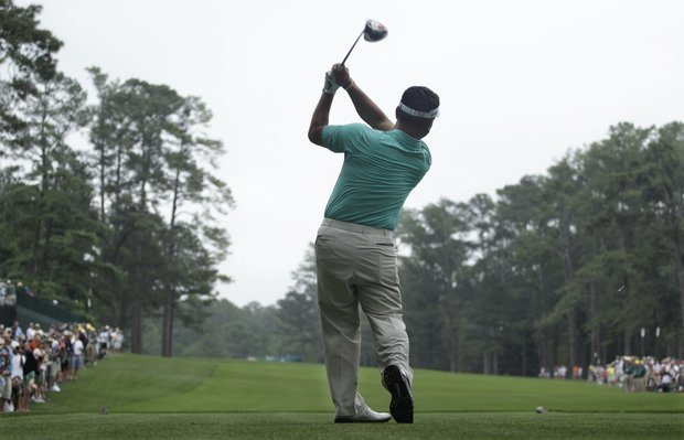 K.J. Choi, of Korea, watches his tee shot on the 14th hole during a practice round for the Masters.
