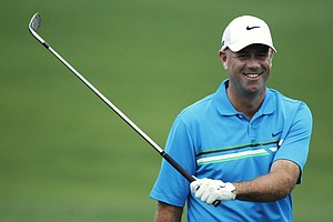 Stewart Cink loosens up on the driving range before his practice round for the Masters.