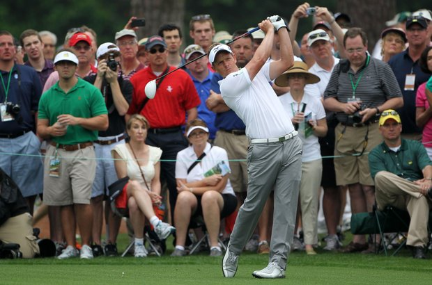 Luke Donald of England hits a tee shot during a practice round prior to the start of the 2012 Masters Tournament at Augusta National.