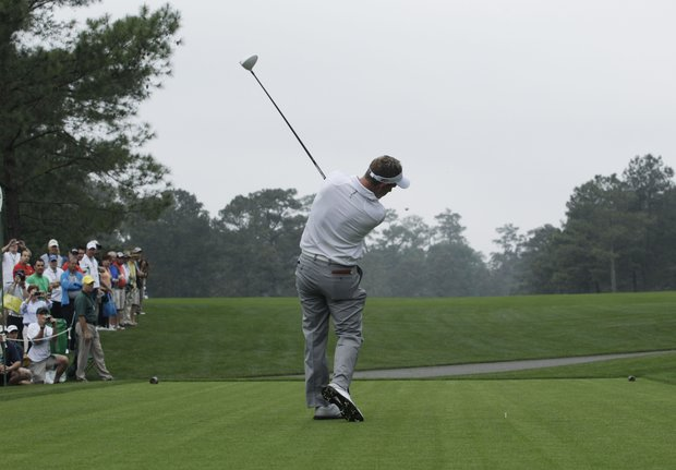 Luke Donald, of England, tees off on the 15th hole during a practice round for the Masters.