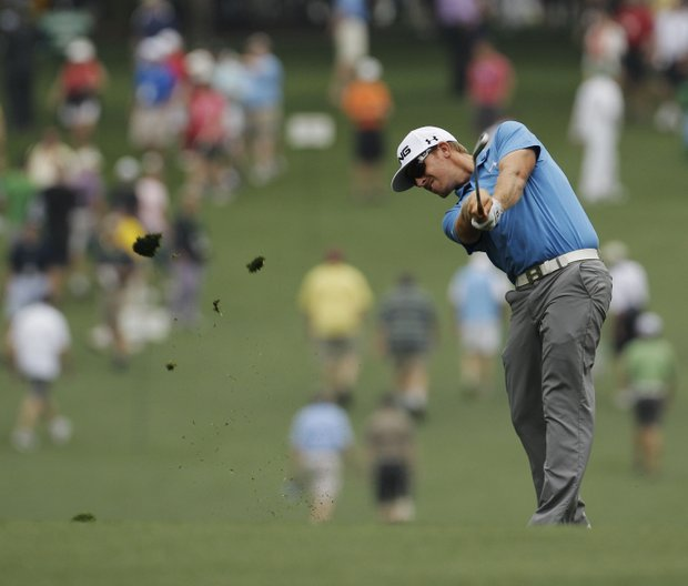Hunter Mahan hits off of the first fairway during a practice round for the Masters.