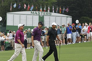 From left, Fred Couples, Sean O'Hair and Tiger Woods walk to the ninth tee during a practice round for the Masters.