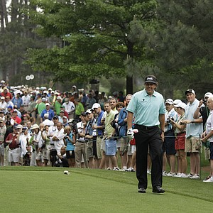 Phil Mickelson walks up to the seventh tee during a practice round for the Masters.