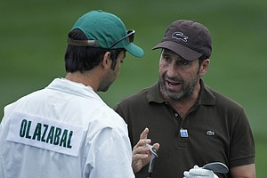 Jose Maria Olazabal, of Spain, chats with his caddie on the driving range before his practice round for the Masters.