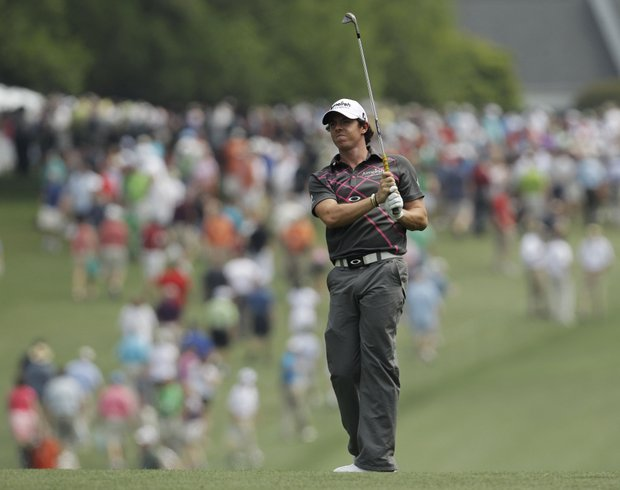 Rory McIlroy, of Northern Ireland, watches his shot from the first fairway during a practice round for the Masters.