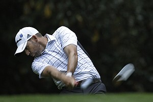 Sergio Garcia, of Spain, tees off on the 11th hole during a practice round for the Masters.