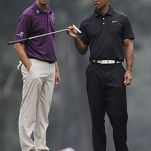 Tiger Woods, right, chats with Sean O'Hair on the third green during a practice round for the Masters.