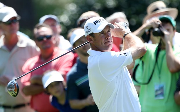 Lee Westwood of England hits a tee shot during a practice round prior to the start of the 2012 Masters Tournament at Augusta National.