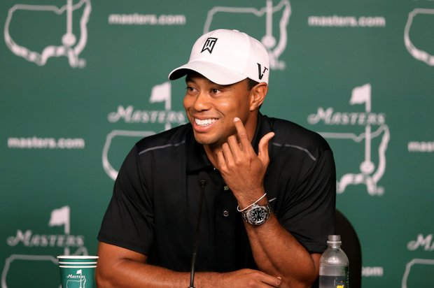 Tiger Woods speaks to the media during a practice round prior to the start of the 2012 Masters Tournament at Augusta National.