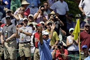 Thomas Bjorn, of Denmark, after making a hole in one on nine during the par three competition at the Masters.