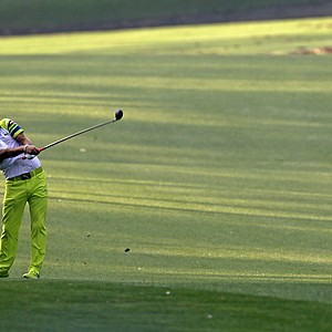 Rickie Fowler hits on the 13th fairway during a practice round for the Masters.