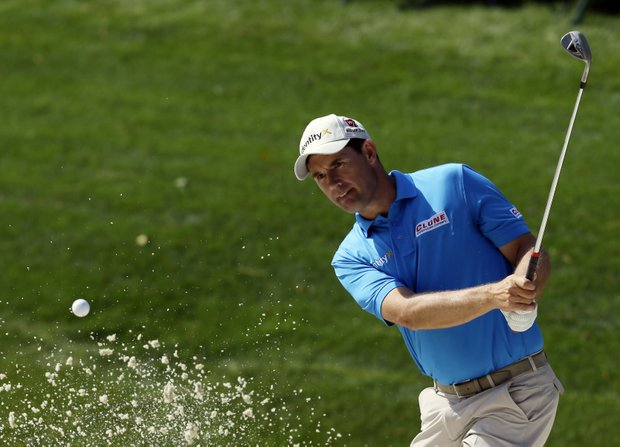 Padraig Harrington, of Ireland, chips onto the 14th green during a practice round for the Masters.