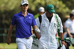 Justin Rose walks with his caddie during a practice round at Augusta.