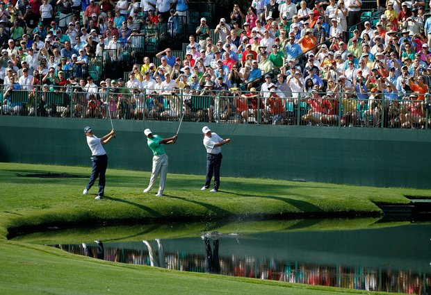 Sean O'Hair, Tiger Woods and Mark O'Meara skip their balls over the water during a practice round at Augusta.