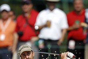 Geoff Ogilvy, of Australia, hits out of the trap on the 17th hole during a practice round for the Masters.