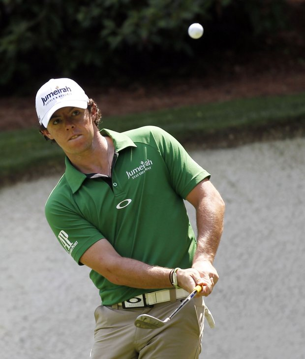 Rory McIlroy, of Northern Ireland, chips to the 13th green during a practice round for the Masters.