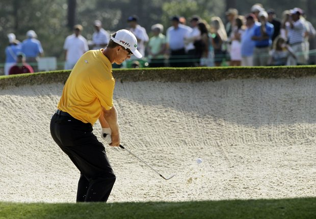 John Senden, of Australia, chips out of a bunker on the seventh hole during a practice round for the Masters.