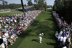Tiger Woods tees off on the 18th hole during a practice round for the Masters.