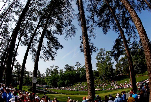 Patrons look on during a practice round prior to the start of the 2012 Masters Tournament at Augusta National Golf Club.