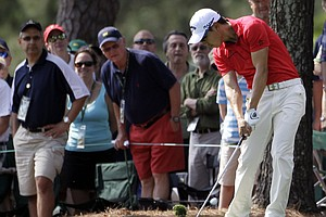 Sang-Moon Bae, of South Korea, hits off the first fairway during the first round of the Masters.